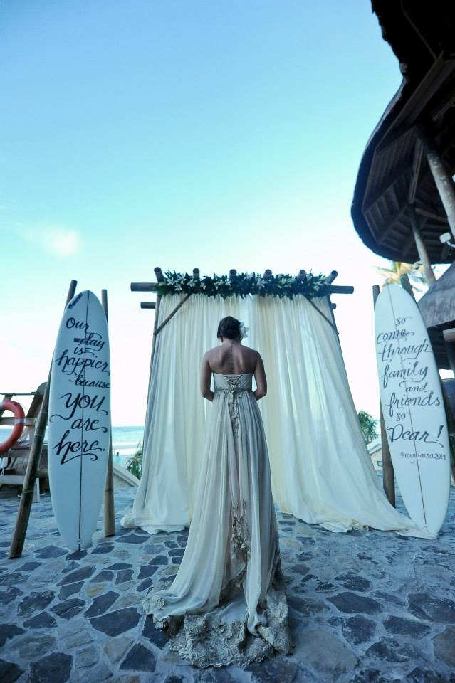 The beautiful bride entering her ceremony with the surfboards at the background. Photo courtesy of Ian Santillan.